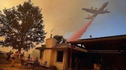 Plane releases fire retardant