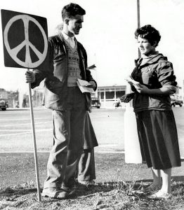marcher with peace symbol in 1958