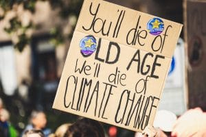 we'll die of climate change sign