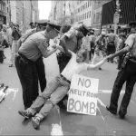 An anti-neutron bomb demonstrator is arrested for sitting in on 5th Ave, New York, New York, August 13, 1981. (Photo by Allan Tannenbaum/Getty Images)