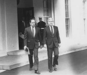 Senators Sam Nunn and Richard Lugar leaving in the White House in November 1991 after briefing President George H. W. Bush on the Nunn-Lugar legislation. US government photo.
