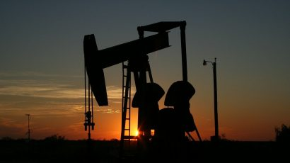 silhouette of oil grasshopper pump at sunset
