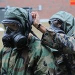 Soldiers practice responding to a chemical or biological weapons attack.