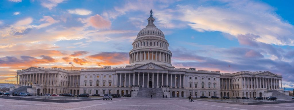 wide photo of US Capitol at sunset