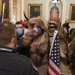 Supporters of US President Donald Trump, including member of the QAnon conspiracy group Jake A, aka Yellowstone Wolf (C), enter the US Capitol on Wednesday. (Photo by SAUL LOEB/AFP via Getty Images)