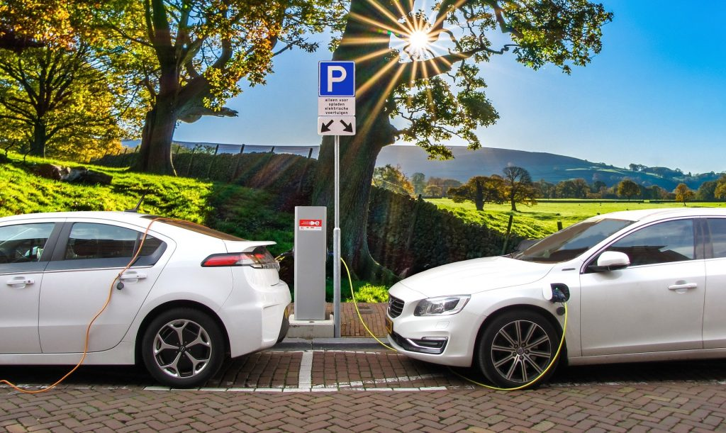 electric cars charging and idyllic backdrop