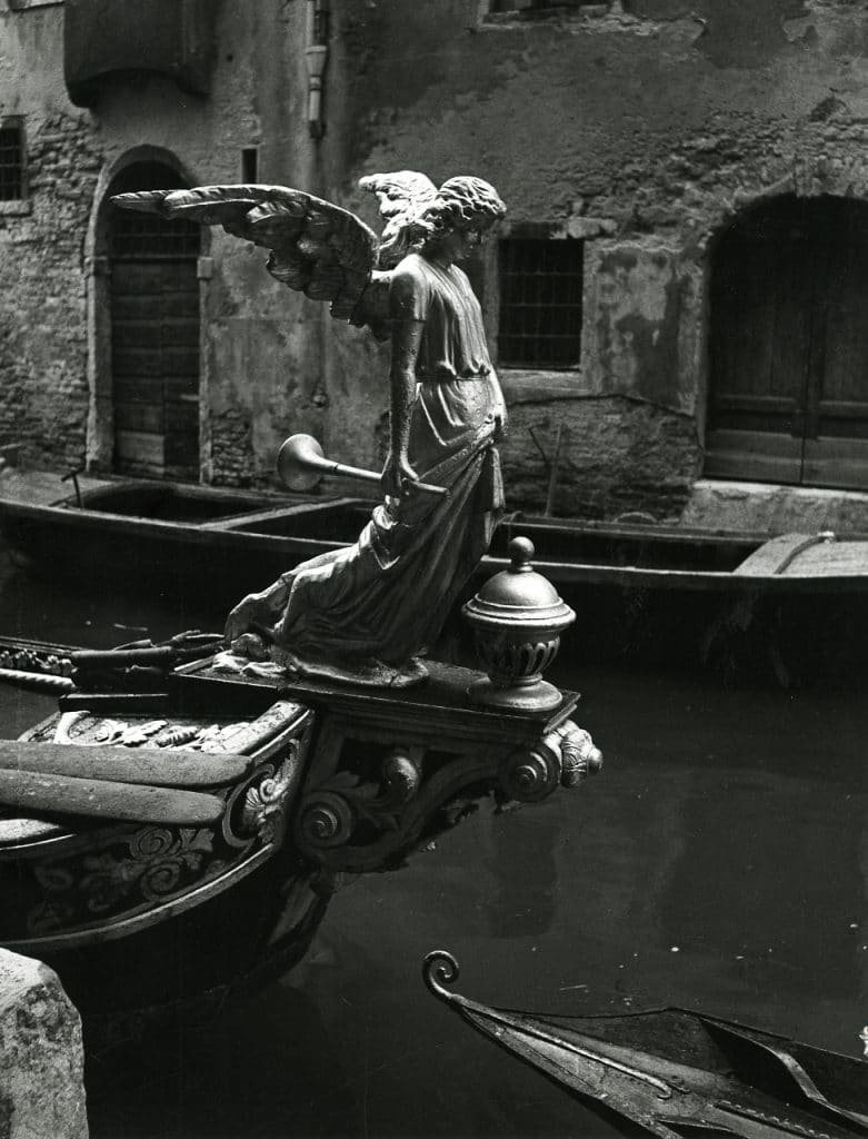 """""""The Angel of Death,"""" sculpture on a funeral gondola, Venice. Photo by Paolo Monti, 1951."""