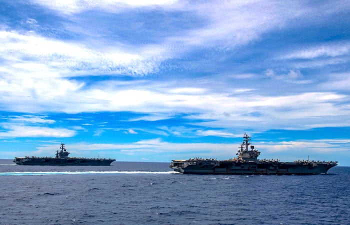 The aircraft carriers USS Nimitz and USS Ronald Reagan transit the South China Sea in July 2020. (Photo credit: US Navy)