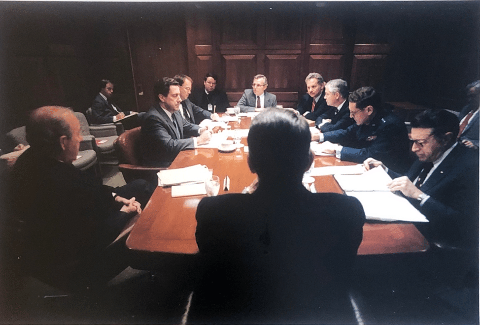 Shultz (front left) and the author (left rear) at a 1987 National Security Council meeting on missile defense and arms control. Other participants, from left to right: Energy Secretary John Herrington, Science Advisor William Graham, Special Assistant to the President and NSC Senior Director Robert Linhard, National Security Advisor Frank Carlucci, Arms Control and Disarmament Agency Director Kenneth Adelman, CIA Deputy Director Robert Gates, Vice Chairman of the Joint Chiefs of Staff Gen. Robert Herres, and Secretary of Defense Caspar Weinberger. (White House photo.)