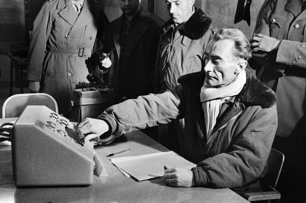 French general pressing a button to trigger third atomic bomb test in the Algerian Sahara