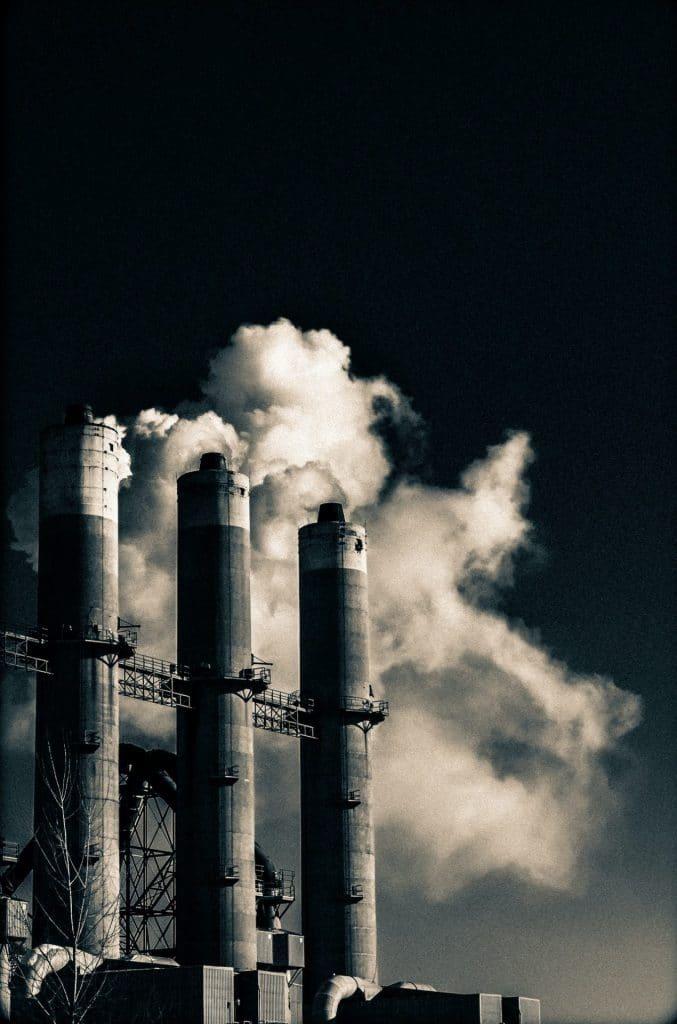 black and white photo of smokestacks