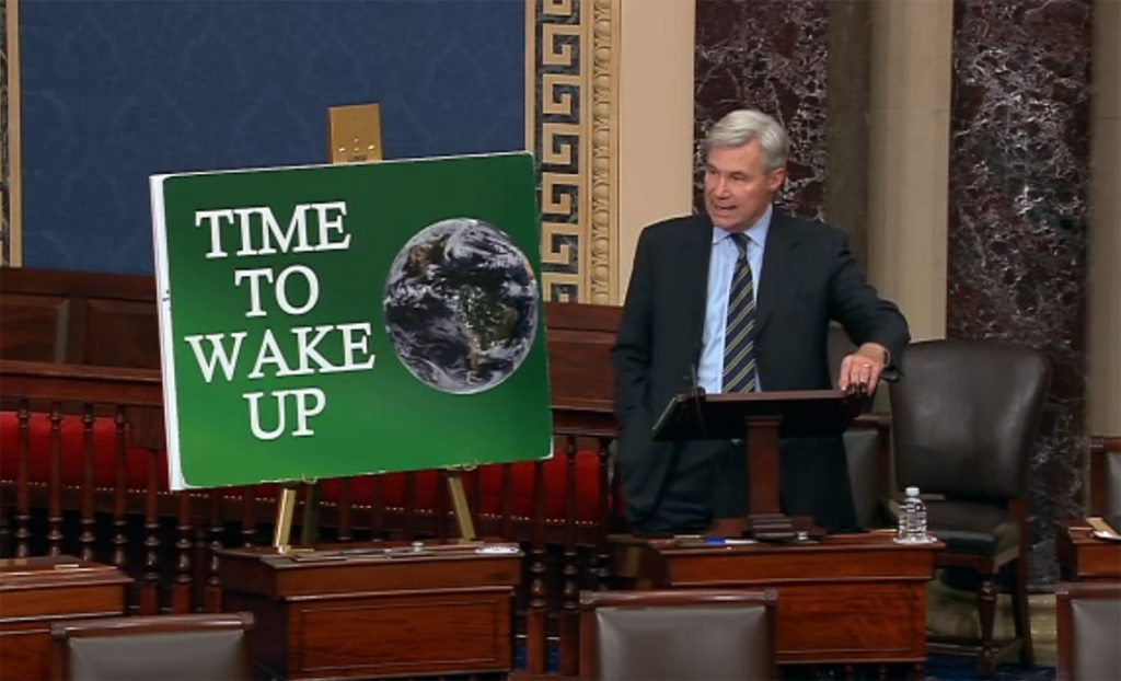 Sheldon Whitehouse and climate activism poster in US Senate