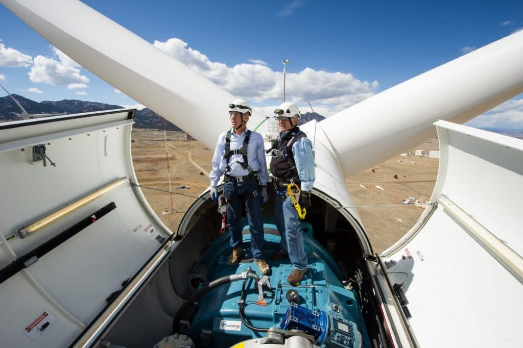 engineers inside top of wind turbine