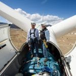 engineers inside top of wind turbine