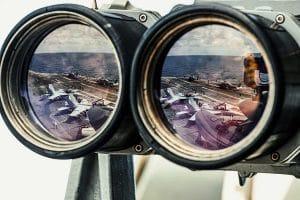 reflection of warplanes in South China Sea in binoculars