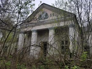Overgrown House of Culture (a community center) at one of the abandoned villages near the Chernobyl Nuclear Power Plant. Credit: Margarita Kalinina-Pohl (2018).