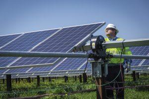 solar panels and technician