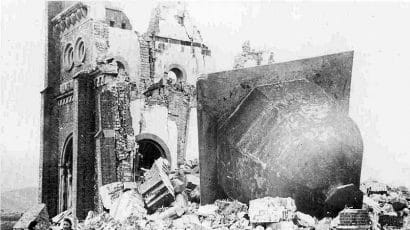 An after-picture of the Urakami Tenshudo (Catholic Church) in Nagasaki, which was destroyed in 1945 by the fission of about one kilogram of plutonium. Credit: Public domain image accessed via Wikimedia Commons.