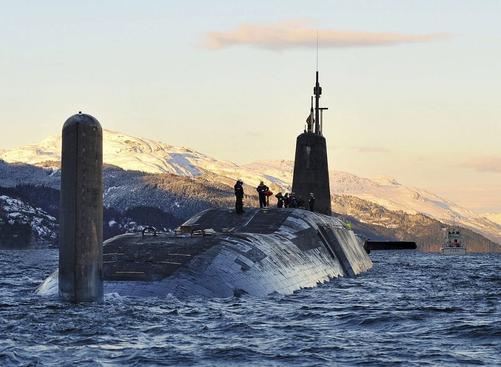 Nuclear submarine HMS Vanguard arrives back at HM Naval Base Clyde, Faslane, Scotland following a patrol. Photo: CPOA(Phot) Tam McDonald/MOD accessed via Wikimedia Commons. Open Government License version 1.0.