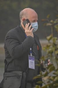 Peter Daszak, a member of the World Health Organization (WHO) team investigating the origins of the COVID-19 coronavirus, talks on his cellphone at the Hilton Wuhan Optics Valley in Wuhan. (Photo by HECTOR RETAMAL/AFP via Getty Images)