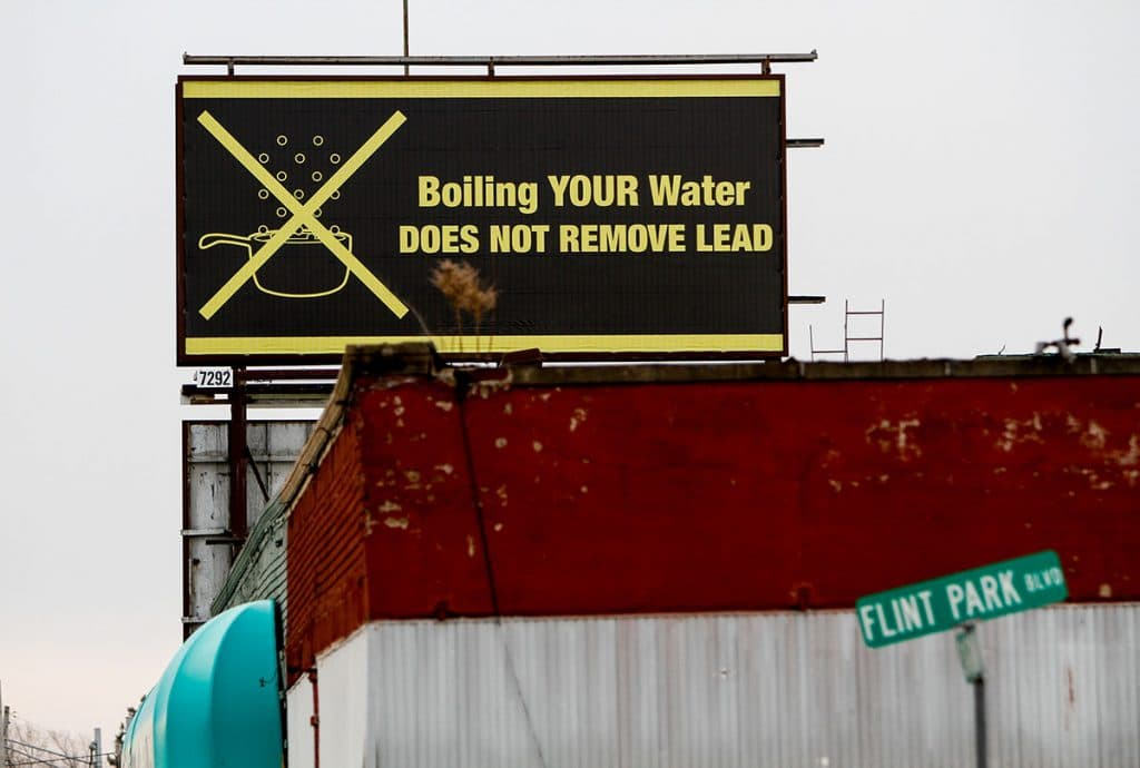 A sign tells Flint, Mich. residents that boiling water doesn't remove lead in Februaary 2016 Months earlier, the city told citizens they could use tap water if they boiled it first. (Photo by Sarah Rice/Getty Images)