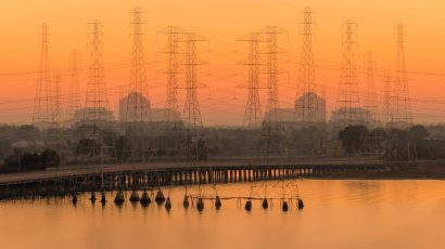 sun rising over power lines in California