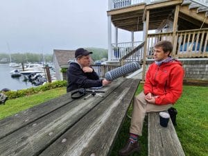 radio reporter interviewing Woods Hole physicist