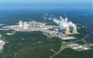 Vogtle reactor site in Georgia, with two operating units to the right and two AP1000 units under construction to the left; Tim Mousseau ©2019. Used with permission.