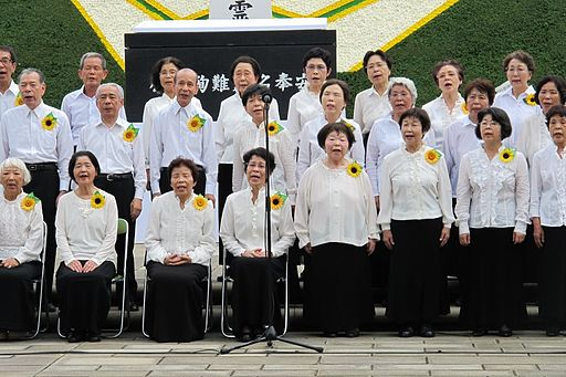 "A choir of Hibakusha (atomic bomb survivors) sing ""Never Again."" Hiroshima-Nagasaki 2012. Credit: The Official CTBTO Photostream. Accessed via Wikimedia Commons."