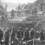 Rescue and clean-up crews search for casualties following the barracks bombing in Beirut on October 23, 1983. If negotiators hope to revive the Iran nuclear deal, they must address the billions of dollars' worth of civil judgments by US victims of terrorism against Iran. Photo credit: United States Marine Corps. Public domain image.