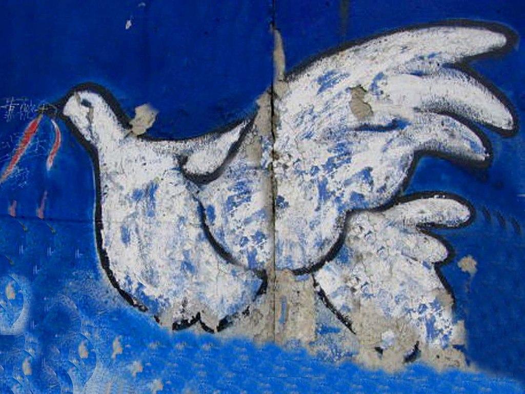 Dove of peace. Street art in Berlin. Credit: Marko Kafé. CC BY-SA 4.0. Accessed via Wikimedia Commons.