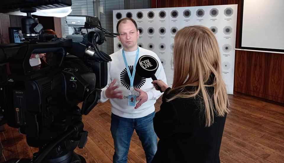 "Maksym Shevchuk introduces the new Chernobyl logo design at a press conference on February 19, 2021. (<a href=""https://www.facebook.com/dazv.gov.ua/photos/pcb.4301699693193449/4301699603193458/"">SAUEZM</a>)"