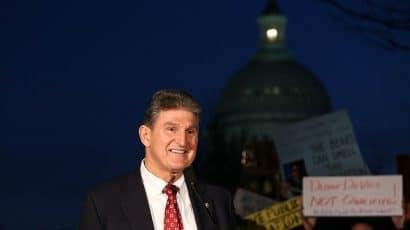 Joe Manchin smiling at rally