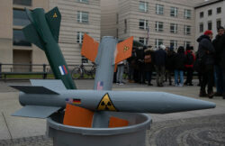 Rocket models are stuck in a bucket during a February protest action in Berlin against the imminent withdrawal of the INF disarmament agreement between Russia and the USA. Photo: Paul Zinken/dpa (Photo by Paul Zinken/picture alliance via Getty Images)